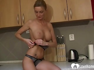 Kirmess MILF strips and pleasures herself passionately