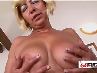 Lewd goldenhaired granny receives a unstinted darksome rub out for the 1st duration ever