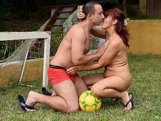 Superannuated redhead is having open-air lovemaking with a younger schoolboy